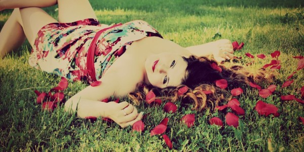 senior pictures laying in the petals